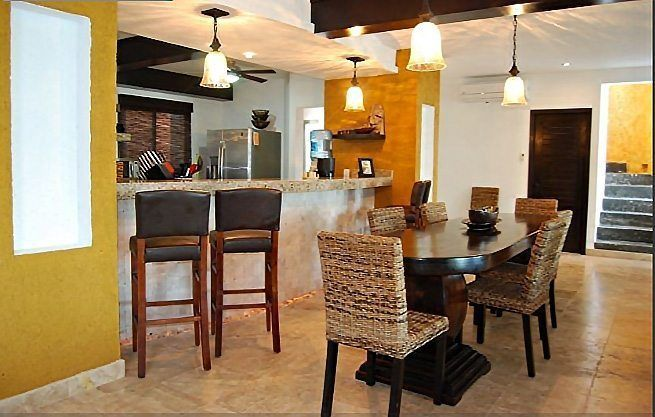 Main Villa Kitchen and Dining Room - Sunken Living Room On Right - Isla Mujeres Vacation Rental